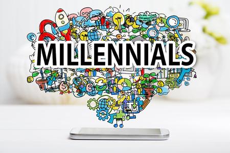 화이트 테이블에 스마트 폰 Millennials 개념