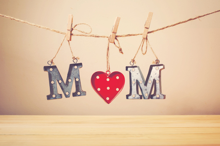 text pink: Mothers day celebration theme with metal MOM letters