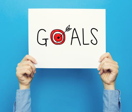 青色の背景に白いポスターの目標テキスト 写真素材