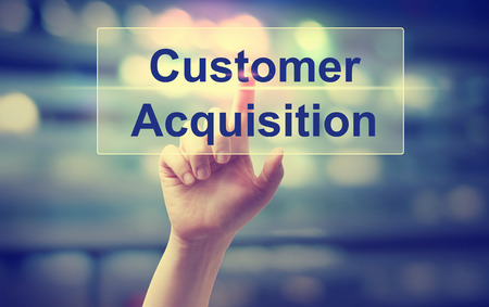 Customer Acquisition concept with hand pressing a button Stock Photo