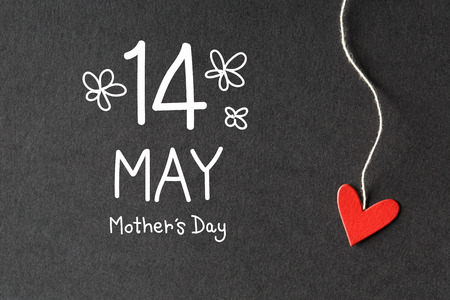 mother: 14 May Mothers Day message with handmade small paper hearts Stock Photo