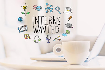 Interns Wanted concept with a cup of coffee and a laptop