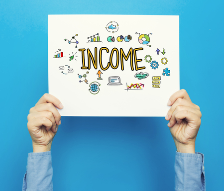 Income text on a white poster on a blue background Imagens