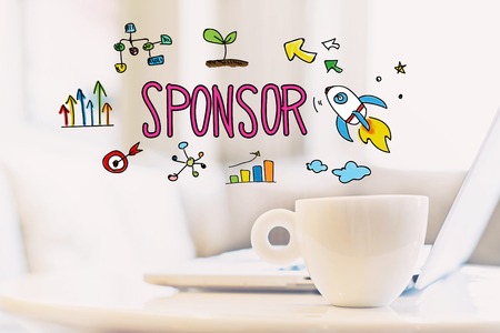 Sponsor concept with a cup of coffee and a laptop Stock Photo
