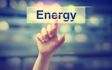 Energy concept with hand pressing a button Stock Photo