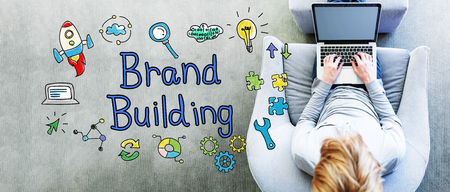 overhead: Brand Building text with man using a laptop