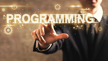 css: Programming text with businessman on dark vintage background