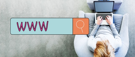 WWW text with man using a laptop in a modern gray chair