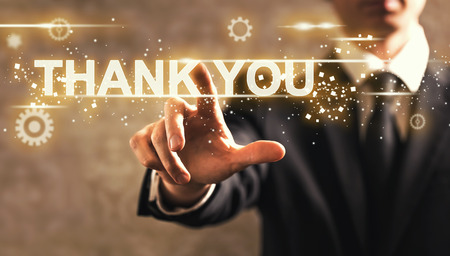 Thank You text with businessman on dark vintage background