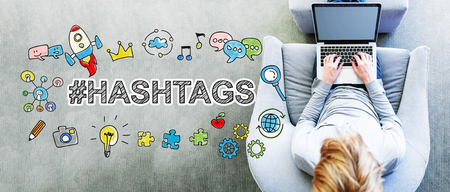 Hashtags text with man using a laptop Stock Photo