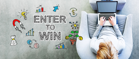 Enter to Win text with man using a laptop Stock Photo