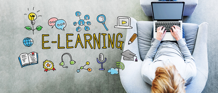 computer education: E-Learning text with man using a laptop