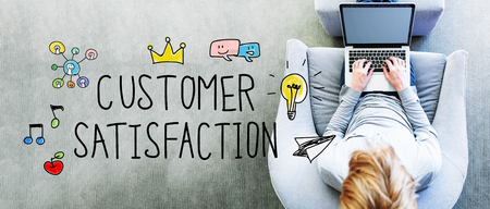 Customer Satisfaction text with man using a laptop