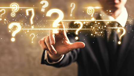 Question Marks with businessman on dark vintage background Stock Photo