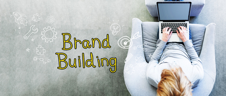 Brand Building text with man using a laptop