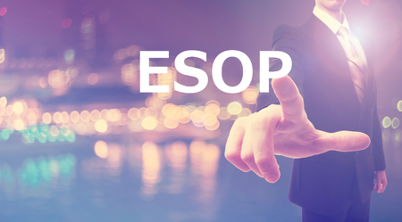 ESOP concept with businessman on blurred city background