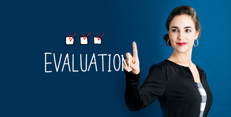 Evaluation text with business woman on a dark blue background Stock Photo