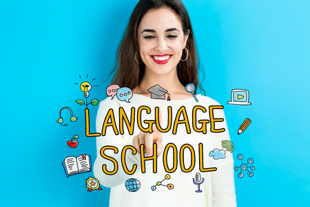 small business woman: Language School  text with young woman on a blue background Stock Photo