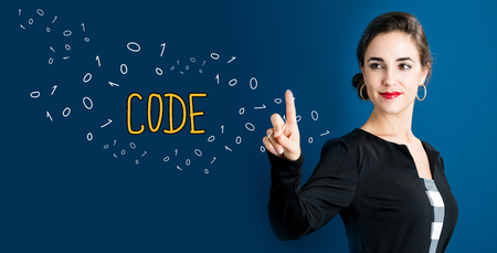 Code text with business woman on a dark blue background Stock Photo