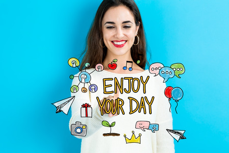Enjoy Your Day text with young woman on a blue background Stock Photo
