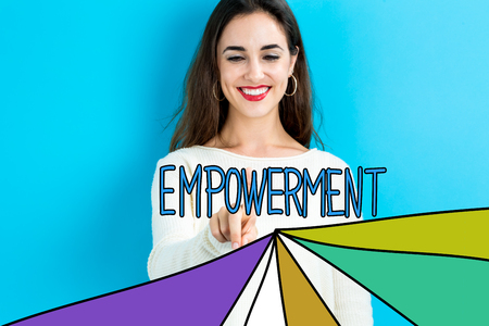 Empowerment text with young woman on a blue background