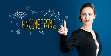Engineering text with business woman on a dark blue background Stock Photo