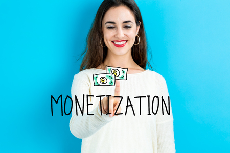 monetization: Monetization text with young woman on a blue background