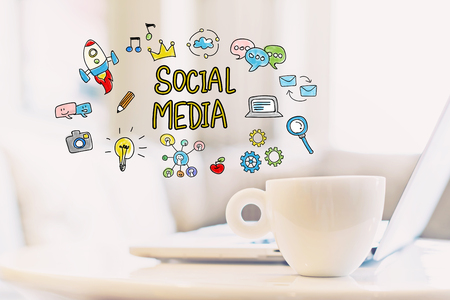Social Media concept with a cup of coffee and a laptop
