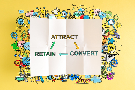 Attract Convert Retain text with colorful illustrations on a yellow background Stock Photo