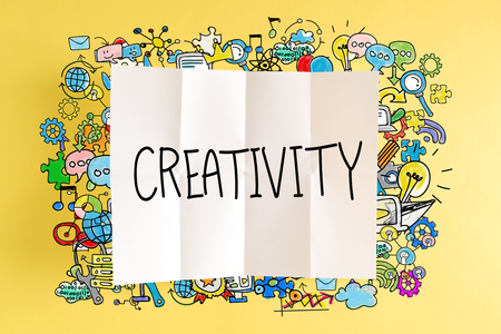 Creativity text with colorful illustrations on a yellow background