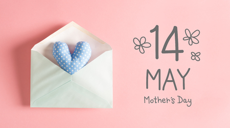 Mothers Day message with a blue heart cushion in an envelope