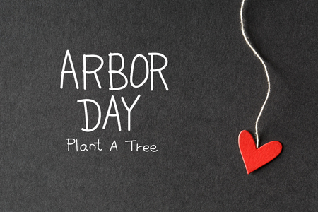 ecological environment: Arbor Day message with handmade small paper hearts Stock Photo