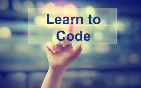 css: Learn To Code concept with hand pressing a button Stock Photo
