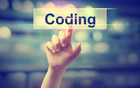 Coding concept with hand pressing a button Stock Photo