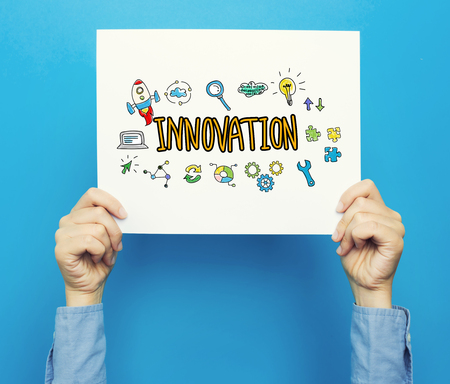 Innovation text on a white poster on a blue background
