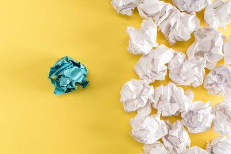 Crumpled paper balls on a yellow background