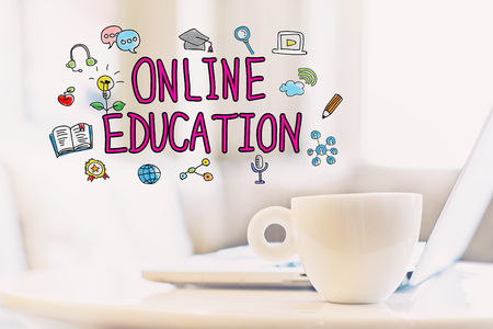 Online Education concept with a cup of coffee and a laptop Stock Photo