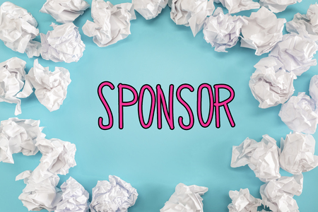 sponsoring: Sponsor text with crumpled paper balls on a blue background