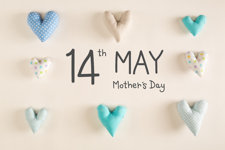Mothers Day message with blue heart cushions on a white paper background Stock Photo