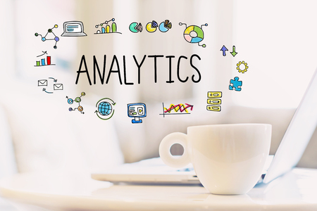 Analytics concept with a cup of coffee and a laptop Stock Photo
