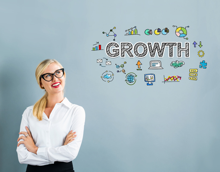 thoughtful: Growth text with business woman on a gray background Stock Photo