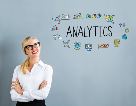 thoughtful: Analytics text with business woman on a gray background Stock Photo