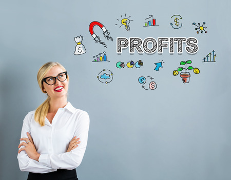 Profits text with business woman on a gray background
