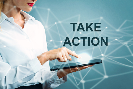 Take Action text with business woman using a tablet