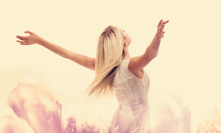 Beautiful woman enjoying her freedom with arms open Stockfoto