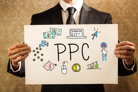 PPC text with businessman holding a sign board