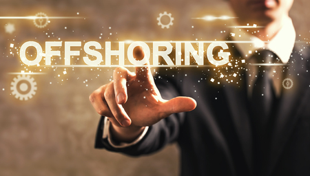 offshoring: Offshoring text with businessman on dark vintage background