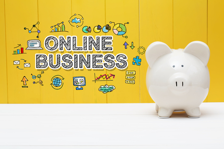 Online Business text with piggy bank over yellow wall