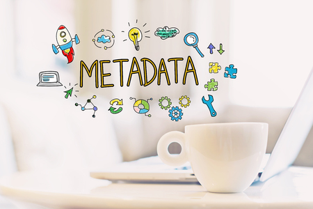 Metadata concept with a cup of coffee and a laptop