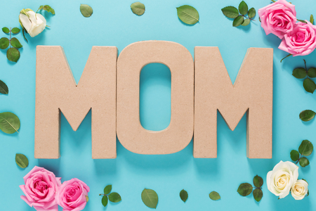 pink flowers: Mothers day celebration theme with MOM letters